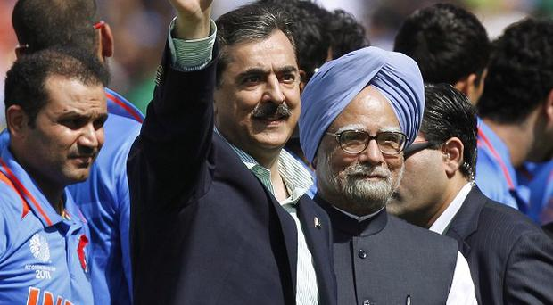 Indian Prime Minister Manmohan Singh, right, and Pakistan Prime Minister Yousuf Raza Gilan at the Cricket World Cup match (AP Photo/Gurinder Osan)