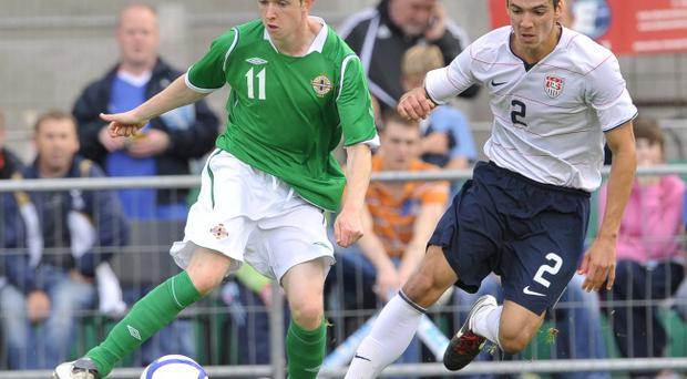 Shane Ferguson (left) in action for Northern Ireland under 21s