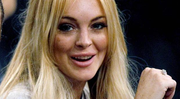 Lindsay Lohan will face charges against her over a December scuffle with a rehab worker