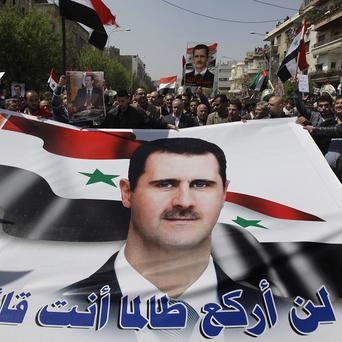 Syrian President Bashar Assad has blamed 'conspirators' for the wave of protests against his authoritarian rule (AP)