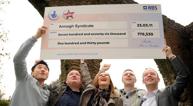 HCL workers Kenny Fong, Declan Mallon, Gillian Greer, Brendan McLaughlin and Greg Mallon celebrate their Lotto win after each banking £155,306
