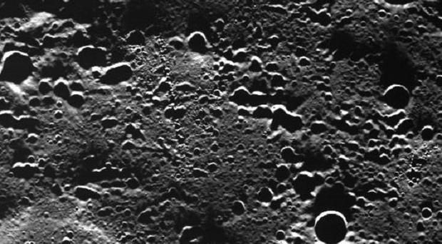 Images from Nasa spacecraft Messenger show the cratered surface of Mercury