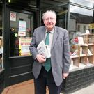 James Simpson outside his newsagents. He says the charges 'don't make any sense'