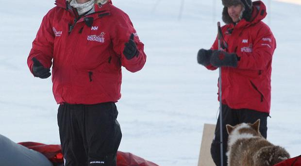 Prince Harry takes down his tent as he joins the Walking With The Wounded team on the island of Spitsbergen before their polar trek