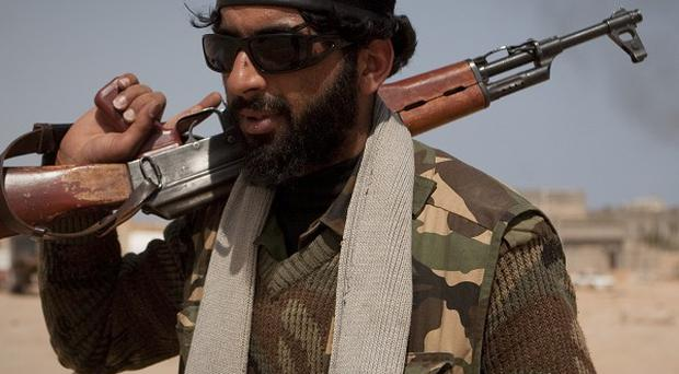 A Libyan rebel on patrol near Bin Jawaad in central Libya (AP)