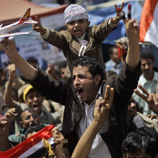 Anti-government protesters shout slogans during a demonstration in Yemen (AP)