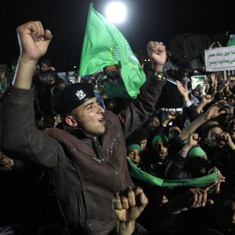 Supporters of Muammar Gaddafi chant slogans during a staged demonstration in Tripoli (AP)