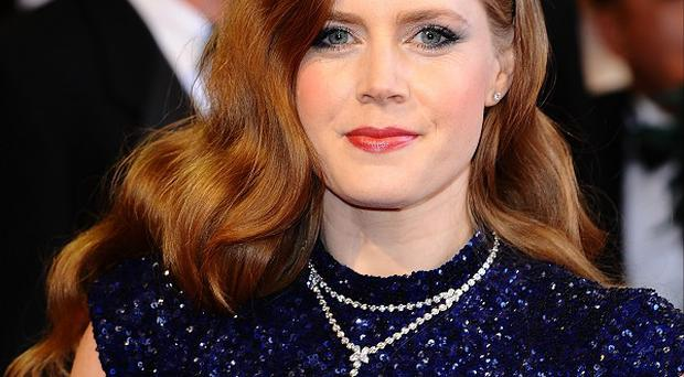 Amy Adams is delighted about being cast as Lois Lane