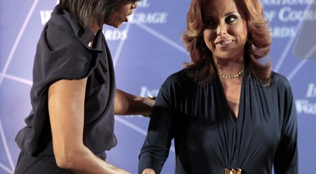 Michelle Obama honors Marisela Morales at the 2011 International Women of Courage Awards ceremony (AP)