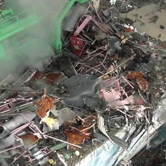 The wreckage of Unit 4 at the Fukushima Dai-ichi nuclear power plant (AP Photo/Tokyo Electric Co via Kyodo News)
