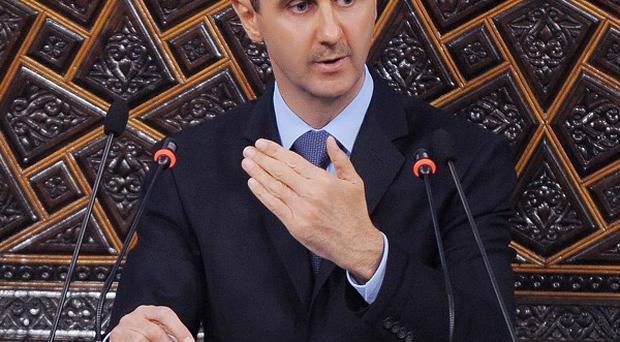 Syrian President Bashar Assad faces new protests in Damscus and around the country on the 'Day of Martyrs' (AP)