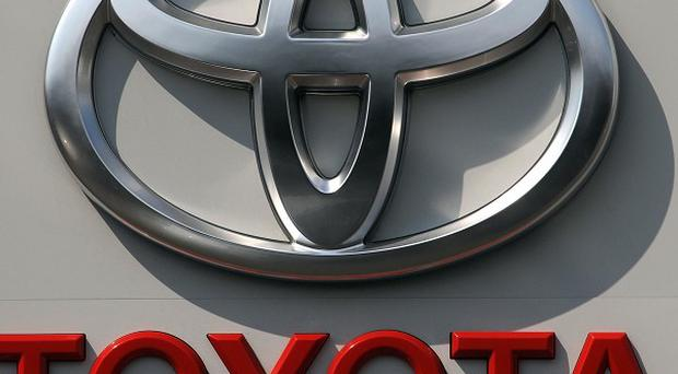 A US jury cleared Toyota over a crash that the driver blamed on the floor mat or the electronic throttle