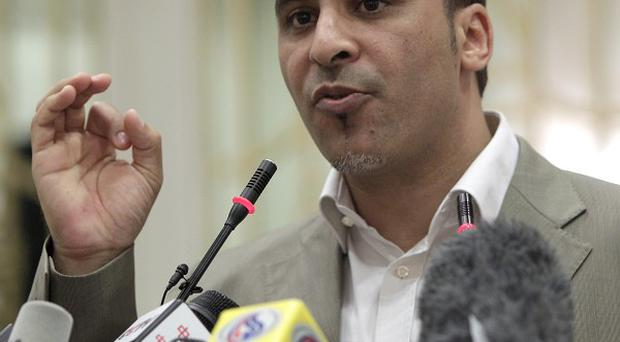 Libyan government spokesman Ibrahim Musa gestures during a press conference in Tripoli, Libya (AP)