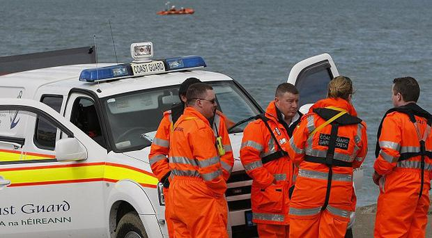 Coast Guard personnel in Skerries Co, Dublin, where fishermen Ronan Browne, 25, and David Gilsenan, 41, have gone missing