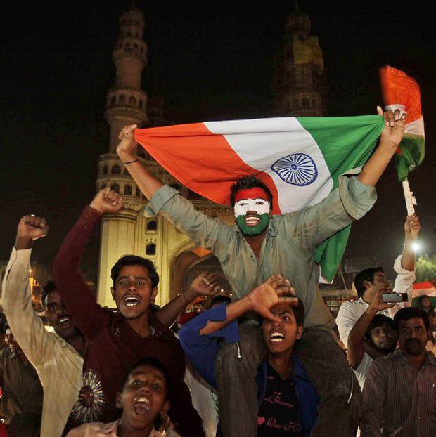 Indian cricket fans in Hyderabad celebrate their team's victory over Sri Lanka in the Cricket World Cup final (AP)