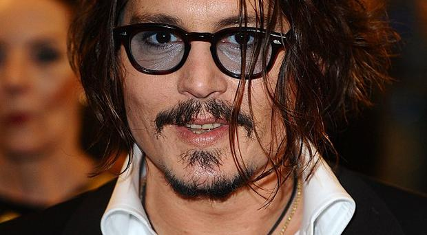 Johnny Depp 'loves' his Pirates Of The Caribbean character