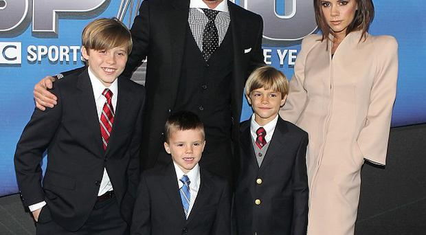 David and Victoria Beckham with sons Brooklyn, Cruz and Romeo