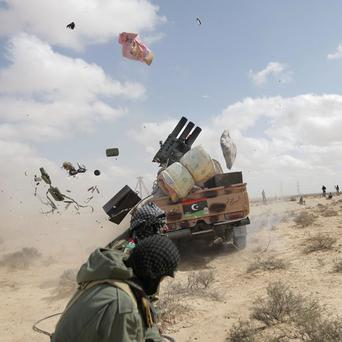 A Libyan rebel rocket launcher misfires while shelling pro Gadhafi forces outside the eastern town of Brega, Libya (AP)
