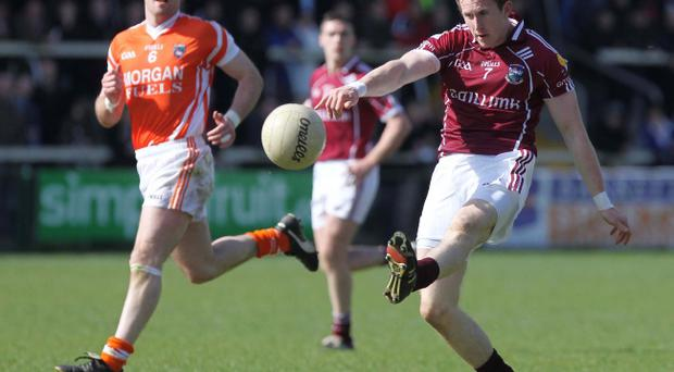 Armagh's Ciaran McKeever looks on as Galway's Gary Sice helps the Tribesmen to a convincing victory yesterday