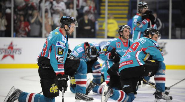 2/4/11: Dejected Belfast Giants players after being beaten 4-1by the Cardiff Devils in the Elite League Play Off Semi Final game in Nottingham. Picture: Michael Cooper
