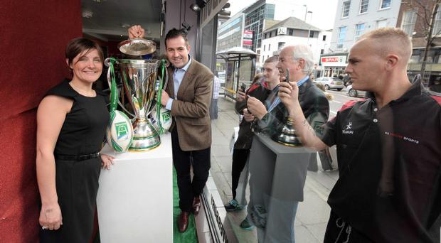 Heineken commercial manager Leza Nulty and the owner of SS Moores, Johnny Moore, get a close up view of the Heineken Cup in Belfast on Saturday