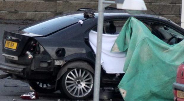 The scene in the Highfield Close area of Omagh after a newly recruited PSNI officer was killed in an under-car bomb attack. April 2011