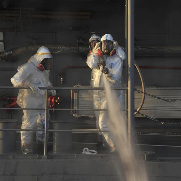 Japanese nuclear safety workers attempt to clean up after radioactive sea water was discovered near the Fukushima plant (AP)