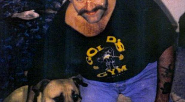 Undated photo of Charles Bronson with his dog Della during time out from prison in 1992