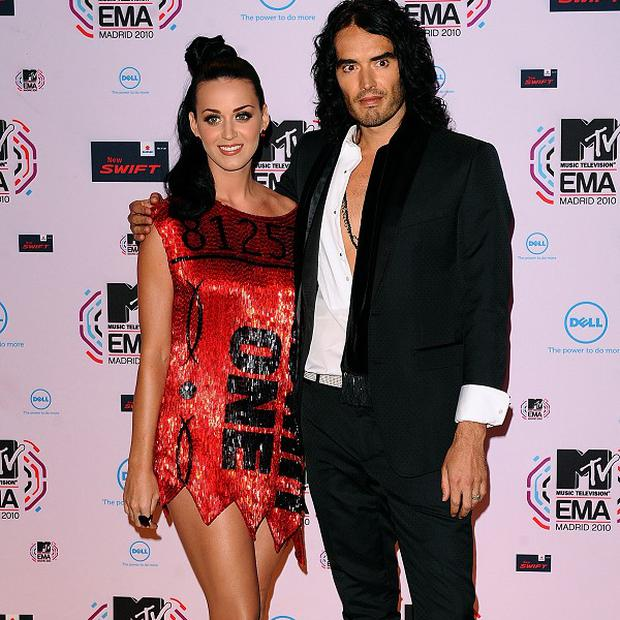 Russell Brand wants to work with his new wife