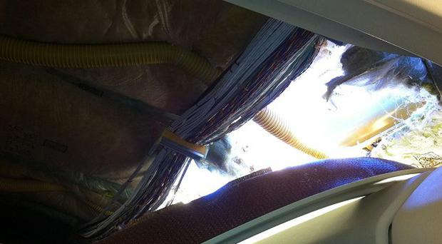 An apparent hole in the cabin on a Southwest Airlines aircraft (AP)