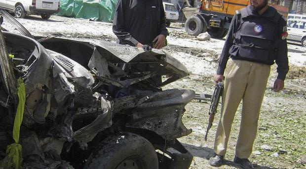 The scene of a suicide attack in Lower Dir, Pakistan (AP)