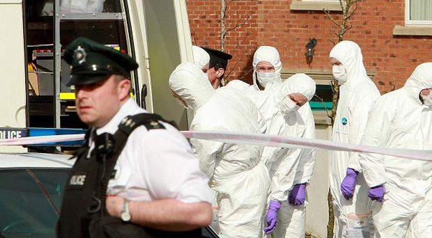 Police and forensic officers at the scene of the tragedy in Omagh