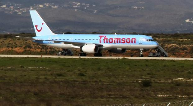 A Thomson Airway's passenger plane on the ground at Athens airport after it made an emergency landing escorted by Greek fighter jets (AP)