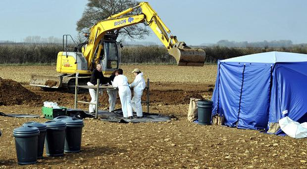 Police forensics at the scene near Eastleach in Gloucestershire, where human remains were found