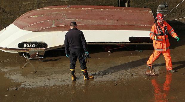 Coast guard personnel and Gardai inspect the 17ft boat named the Lady Linda