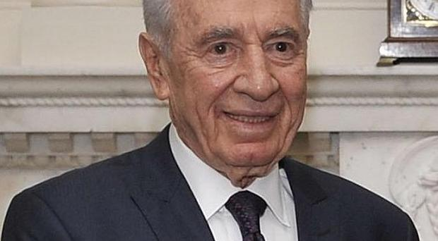 Israeli president Shimon Peres's trip to the US has been overshadowed by plans to build Jewish homes in Jerusalem