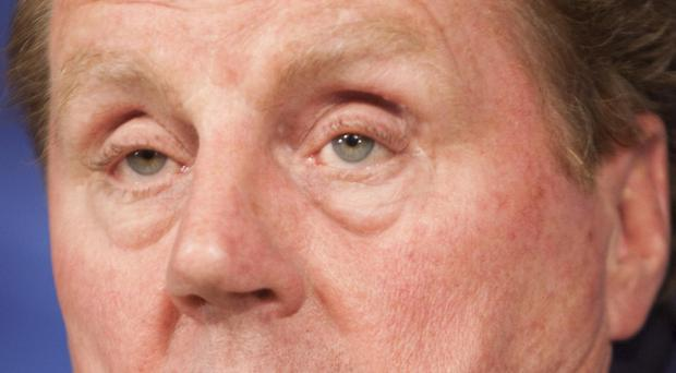 Tottenham Hotspur manager Harry Redknapp reacts during a news conference in Madrid, Spain, Monday, April 4, 2011