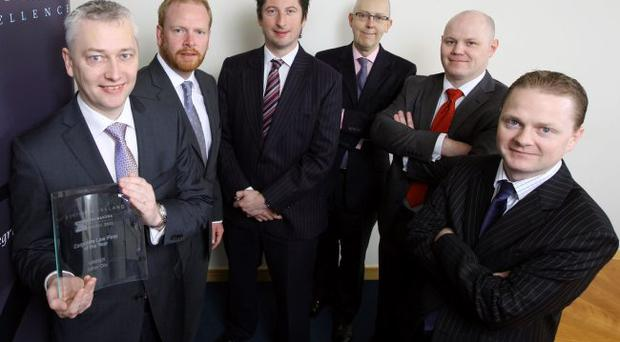 Picking up their award for Corporate Law Firm of the Year at Northern Ireland's first Insider DealMakers awards, from left to right, were Alan Taylor, managing partner of Arthur Cox, and fellow partners Alan Bissett, Alastair Todd, Rowan White, Kieran McGarrigle and Stephen Dobson