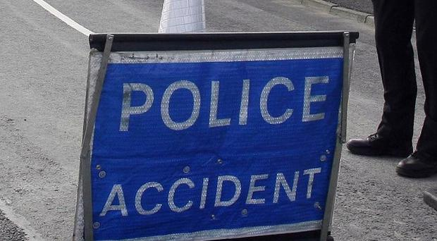 A teenager is in police custody after a 26-year-old man died in a car crash in Omagh