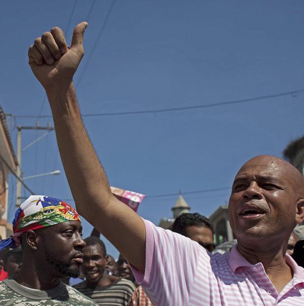 Musician Michel Martelly, right, pictured here with fellow singer Wyclef Jean, has won Haiti's presidential election