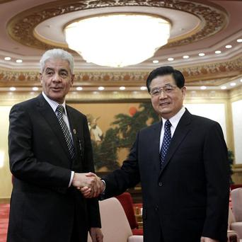 Libya former foreign minister Musa Kusa, right, with China's President Hu Jintao (AP)