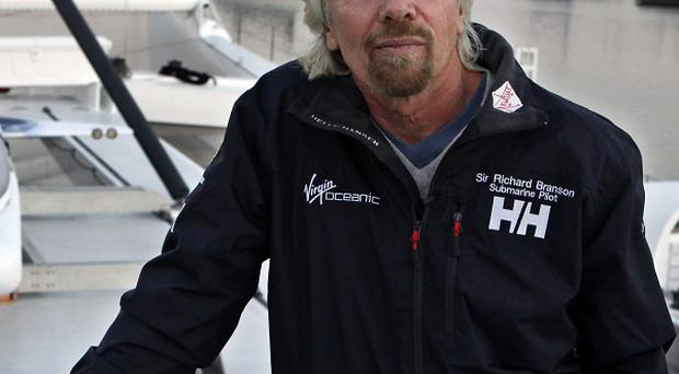 Richard Branson in front his deep sea submarine (AP Photo/Reed Saxon)