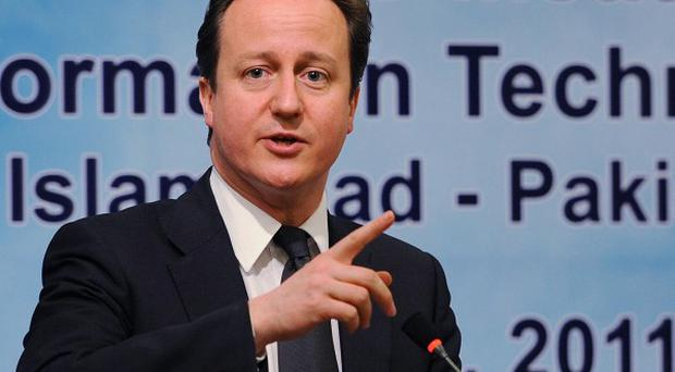Prime Minister David Cameron has promised aid to Pakistan as part of a push for better relations with the country