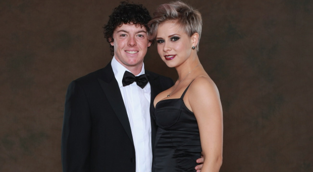 Rory McIlroy poses with Holly Sweeney prior to the 2010 Ryder Cup Dinner at the Celtic Manor Resort on September 29, 2010