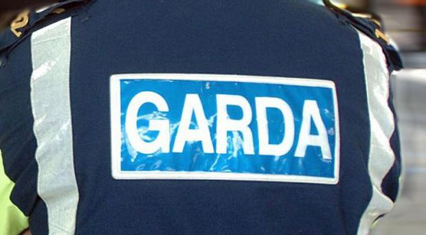 Four men ordered an An Post worker to take cash from the GPO while his family were held hostage, gardai have said