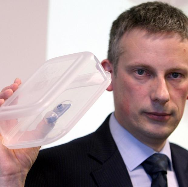 Detective Superintendent Raymond Murray with a plastic box, similar in shape and size to the bomb which killed Constable Ronan Kerr