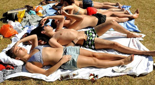 A new campaign promotes the use of suntan lotion and covering up in midday sun