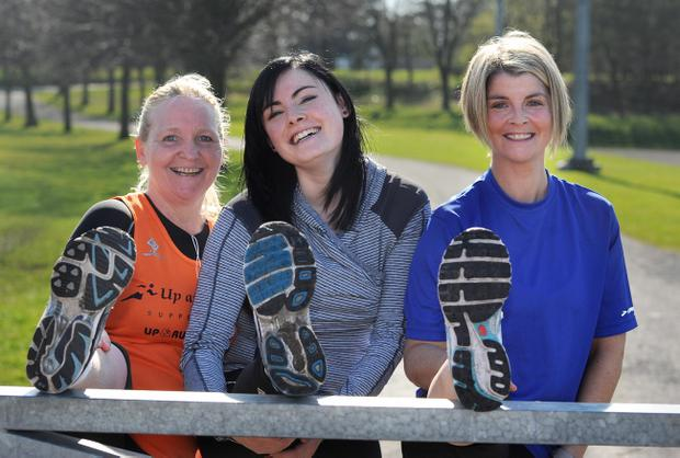Over 50 ladies were at the Ozone on Saturday for a warm-up training session for the Runher Roadrace in May. The runners did a session of 5 x 1k around Ormeau Park. (L-R) Francis Smith, Caroline Cavanagh, and Sinead Owens