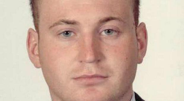 Police hunting the killers of Pc Ronan Kerr have arrested a suspect after discovering a 'significant' haul of arms (PSNI/PA)