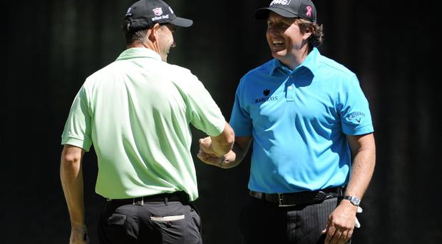 Padraig Harrington shakes hands with Phil Mickelson during the Par 3 Contest prior to the 2011 Masters Tournament at Augusta National Golf Club on April 6, 2011 in Augusta, Georgia
